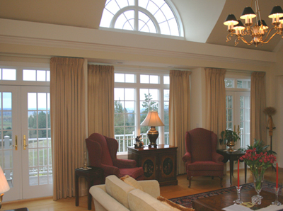 Spacious Living Room with Barrel Windows and Deck