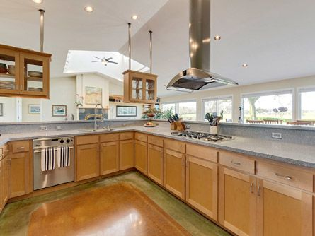Spacious kitchen with gas range and stainless hood