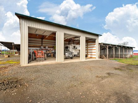 Farm equipment or RV storage building with roll-up doors